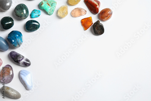 Different beautiful gemstones on white background, top view - 298512698
