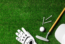 Flat Lay Composition With Golf Equipment On Green Course. Space For Text