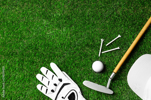 Slika na platnu Flat lay composition with golf equipment on green course