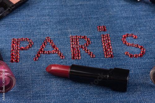 Inscription PARIS inlaid with red rhinestones on denim. Canvas-taulu
