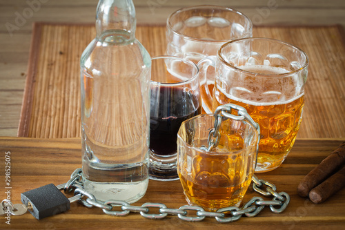 Photo Problem with alcohol, Vodka,wine,whiskey,beer on the table locked with a chain a