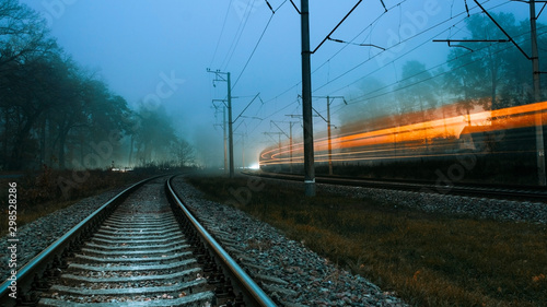 Railroad on a foggy evening Poster Mural XXL