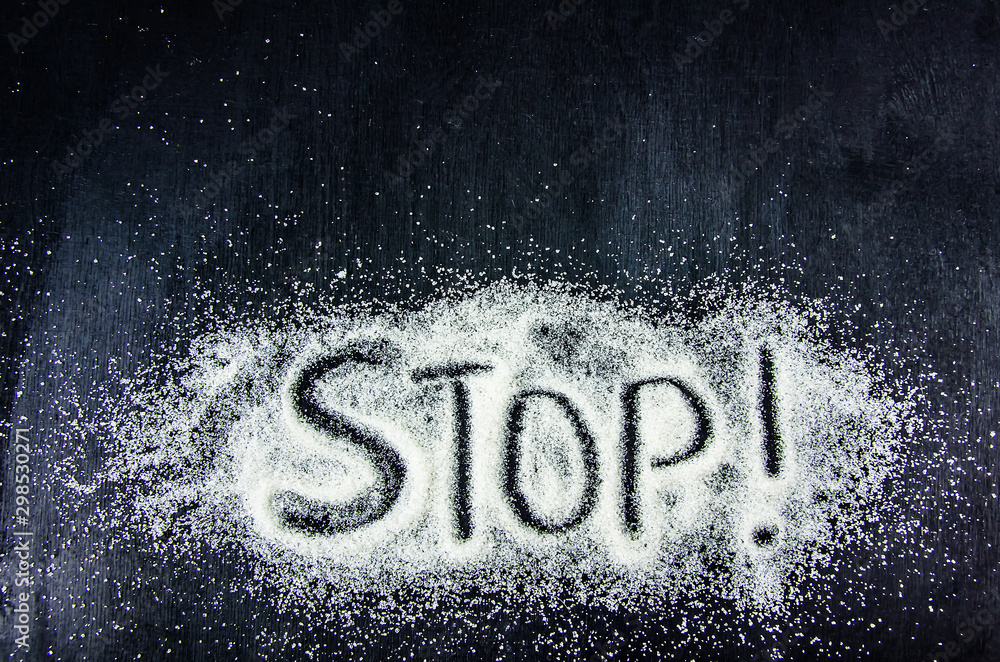 Fototapety, obrazy: top view of the word stop on the sugar sand