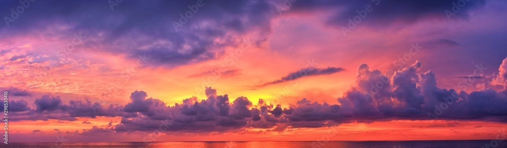 Fototapety, obrazy: Phuket beach sunset, colorful cloudy twilight sky reflecting on the sand gazing at the Indian Ocean, Thailand, Asia.
