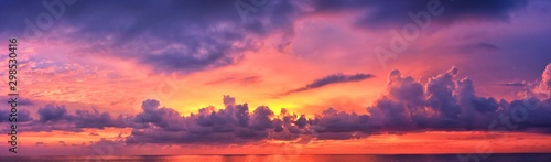 Phuket beach sunset, colorful cloudy twilight sky reflecting on the sand gazing at the Indian Ocean, Thailand, Asia. - 298530416