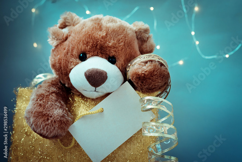 mata magnetyczna Christmas card with Teddy Bear. With holiday decoration and presents