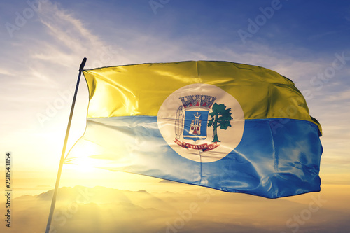 Fotografija Santarem of Brazil flag waving on the top sunrise mist fog