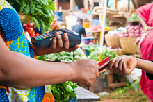Holding A Pos Machince And Receiving Of Credit Card In A Market