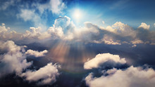 Flying Through Heavenly Beautiful Sunny Cloudscape. Amazing Of Golden Fluffy Clouds Moving Softly On The Sky And The Sun Shining Through The Clouds With Beautiful Rays And Lens Flare.