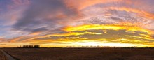 Wide Panoramic Landscape Autumn View Of Natural Prairie Grassland And Great Sunset Sky Colors On Nose Hill Urban Park, Calgary Alberta Canada