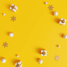 Christmas Decorations With Gift Box On Yellow Background. 3d Rendering
