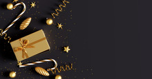 Christmas Decorations With Gift Box On Black Background. 3d Rendering