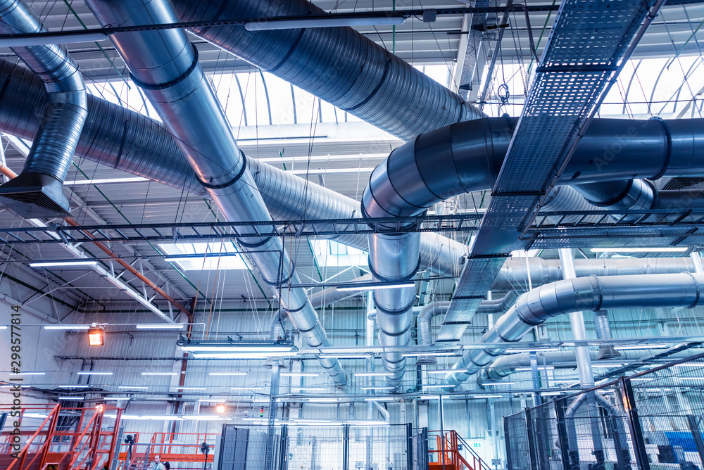 Fototapeta Air conditioning of buildings. Background of ventilation pipes. Laying of engineering networks.