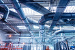 Leinwanddruck Bild - Air conditioning of buildings. Background of ventilation pipes. Laying of engineering networks.