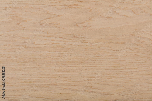 Beautiful oak veneer background in elegant beige color. High quality wood texture.
