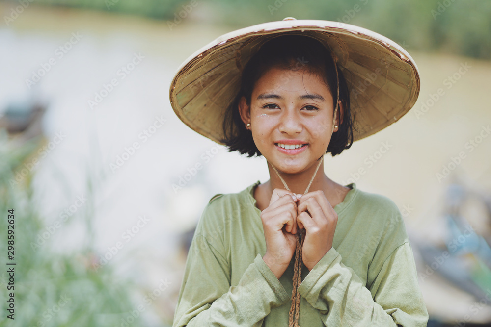 Fototapeta Portrait of Asian Beautiful Burmese girl farmer in Myanmar