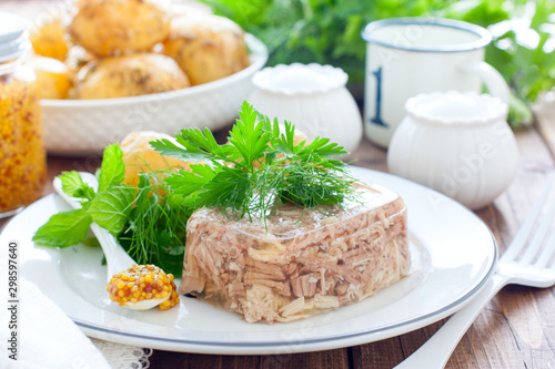 Homemade Aspic of turkey meat on a white plate with boiled potatoes, horizontal Wallpaper Mural