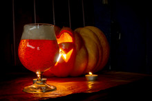 Helloween Glass Of Beer And Candle On Black Background