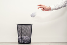 Businessman Throwing Waste Paper To Trash Can In Office
