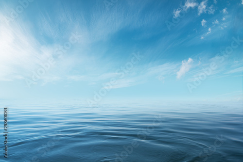 Blue sea or ocean with sunny and cloudy sky