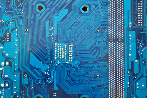 PCB of computer motherboard close-up. Electronic and computer technology. Technology of scientific knowledge, electronics repair, information recovery. Yellow background. Selective soft focus. - 298601239