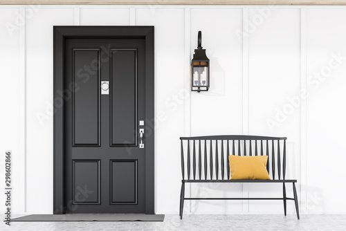Photo Black front door of white house with bench