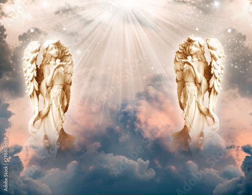 two angel archangels with god rays of lights like spiritual and religious concep Wallpaper Mural