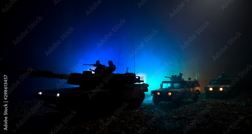 Fototapety, obrazy: Military patrol car on sunset background. Army war concept. Silhouette of armored vehicle with soldiers ready to attack. Artwork decoration. Selective focus