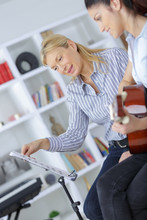 Young Woman Learning Guitar