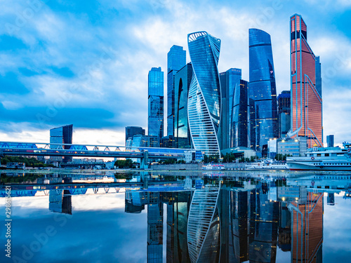 Moscow City. Russia. Krasnopresnenskaya embankment. High-rise buildings in the center of Moscow. Skyscrapers are reflected in the river. Buildings of Moscow. Traveling to the cities of Russia. - 298615621