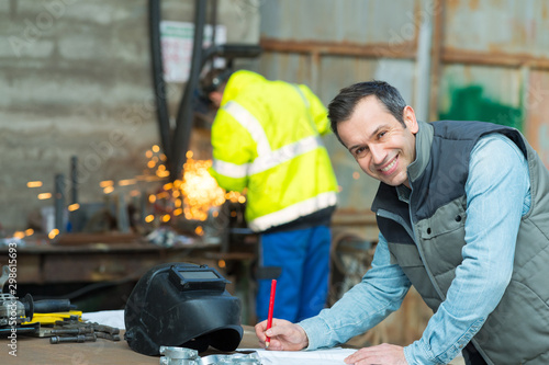 Foto auf Gartenposter Individuell happy industrial steel welder worker at factory workshop