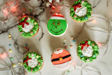 Samara, Russia - 7.10.2019: Christmas Cupcakes Decorated With Cream And Made In The Form Of A Grinch Who Stole Christmas