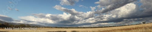 Fotografie, Obraz  Panoramic view of large open dry drought affected farm fields under stretching c