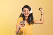 Young Woman Listening Music Wi...