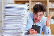 canvas print picture - Funny accountant bookkeeper working in the office
