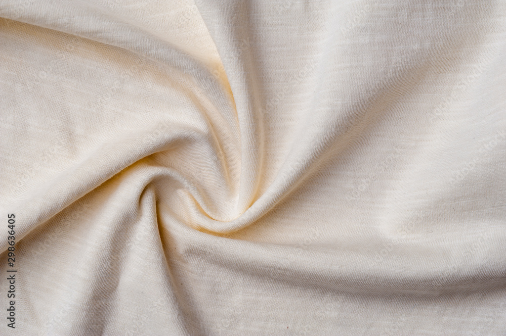 Fototapety, obrazy: Fragment of crumpled light cotton linen fabric