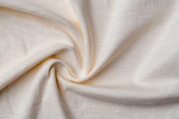 Fragment of crumpled light cotton linen fabric