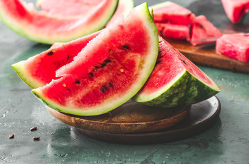 Plate with slices of ripe watermelon on table