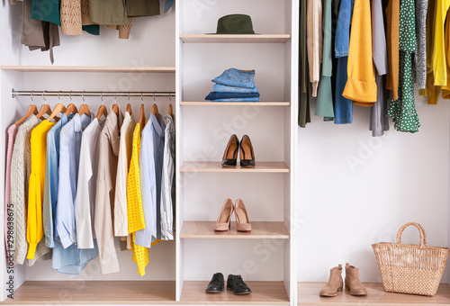 Big wardrobe with clothes in dressing room Canvas-taulu