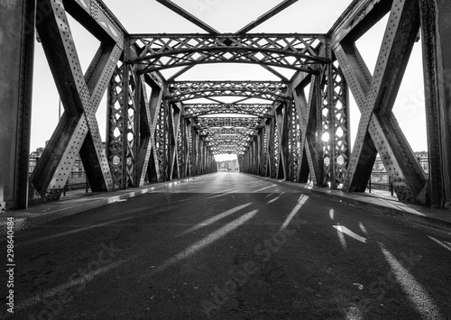 Fototapeta most   black-and-white-asphalt-road-under-the-steel-construction-of-a-bridge-in-the-city-on-a-sunny