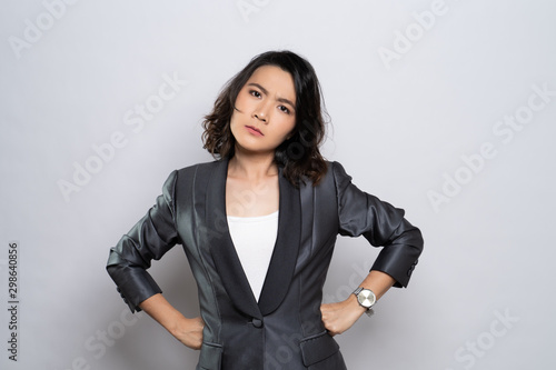 Angry woman standing isolated over white background Canvas Print
