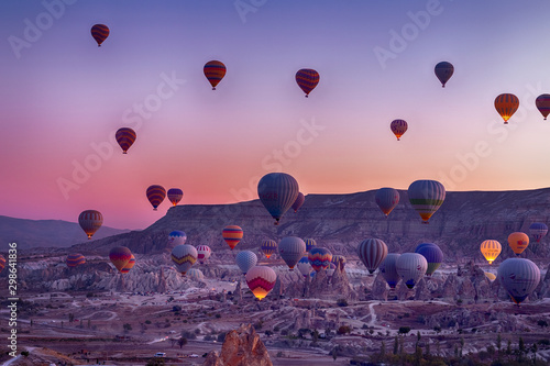 Montage in der Fensternische Aubergine lila Hot Air balloons flying tour over Mountains landscape autumn sunrice Cappadocia, Goreme National Park, Turkey nature background.