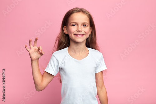 cheerful beautiful blonde girl showing okay sign, close up portrait, body langug Canvas Print