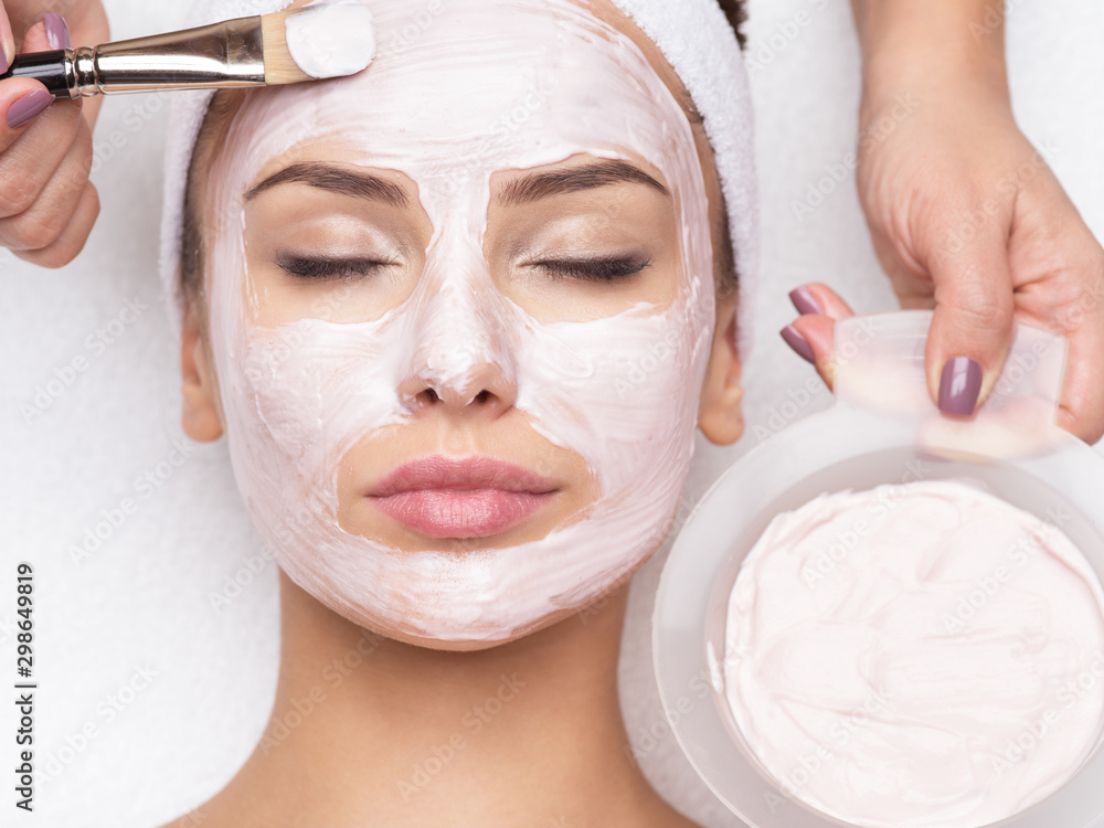 Fototapety, obrazy: woman receiving  facial mask in spa beauty salon