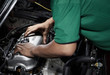 Dress valve cover. Auto mechanic working in garage. Close the cover part.
