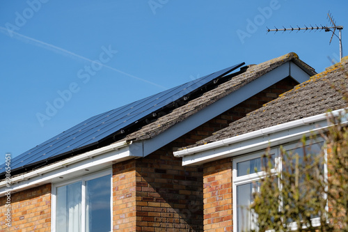 Isolated, shallow focus of newly installed Solar panels on a detached house Fototapet