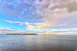 Fototapeta Rainbow - Colorful views of the rainbow against the sky, clouds and sea horizon. Commencement Bay,Tacoma,USA      A.
