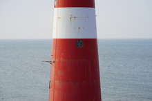 Red Lighthouse On The Beach