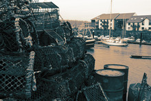 Lobster Crab Pots Stacked On A Quayside.  With Colour Toning