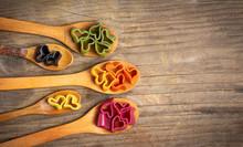 Heart Shape Macaroni Pasta On Wooden Spoons